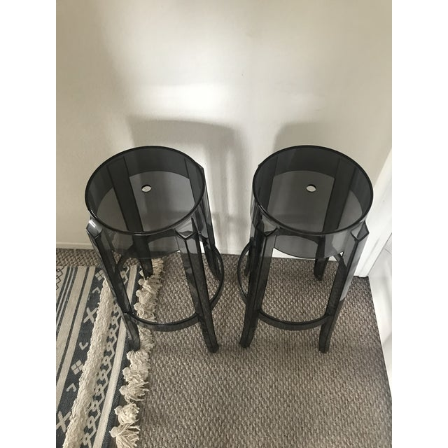 "Set of 2 authentic Kartell Charles ghost bar stools in smoke color. Bar Option: Height 29.5"", Diameter 18.1"" Bar Option..."