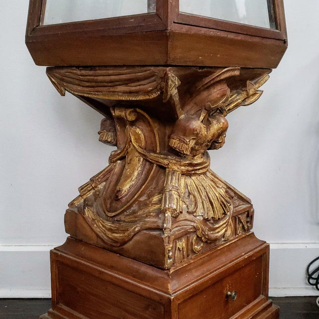 Fantastic and sculptural curio cabinet. Made from fruitwood with partial gilding. This is a great piece for a smaller...