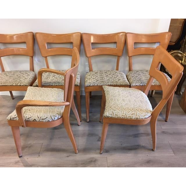 """Heywood-Wakefield's signature """"Dog Biscuit"""" Dining Side Chair is a mid-century modern classic, widely considered one of..."""