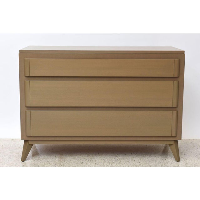 The rectangular top above three drawers with rounded edges, on splayed tapering short legs. Manufactured by R- Way...
