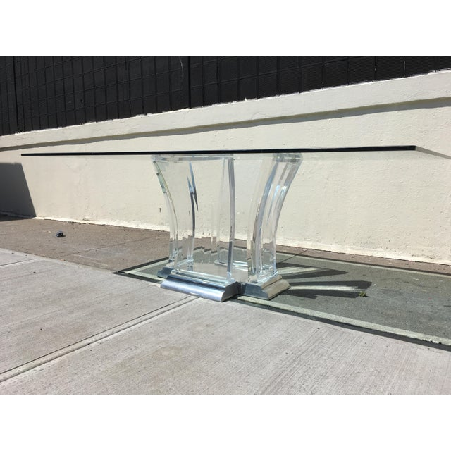 From the 1980's The Jeffery Bigelow table is a stunning piece of lucite and nickel sculpture. It is signed on the...