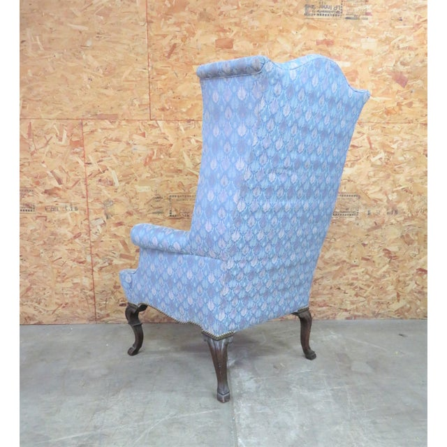 Chippendale wing chair with extra tall back ,carved mahogany legs brass tack trim, seat height 19.5