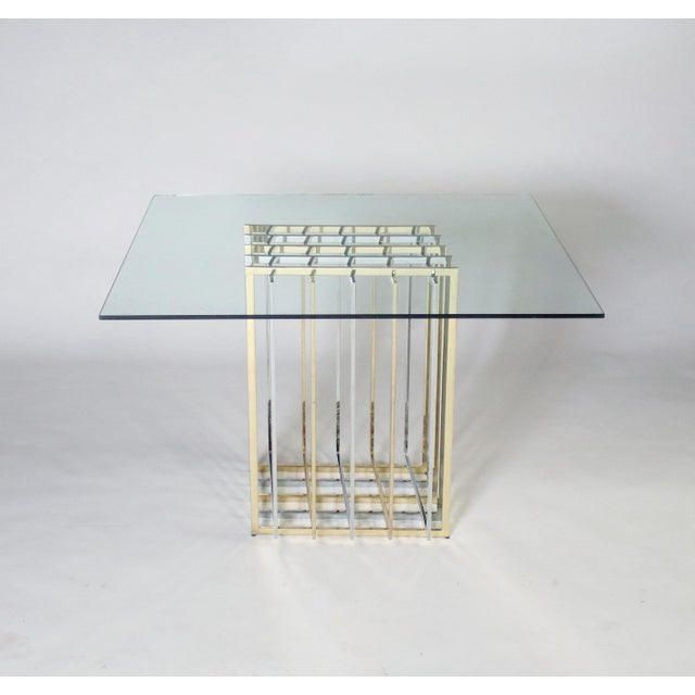 Classic 1970's grid design table by Pierre Cardin in polished chrome and brass. This table base can be topped with a round...