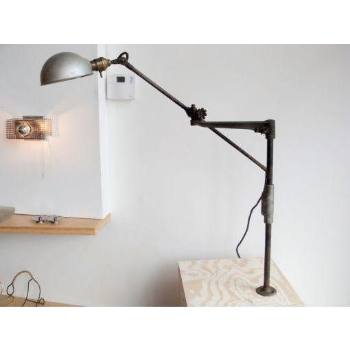 O.C. white industrial task lamp, original head on articulating arm measuring 33″ [head to end of rod], body with signature...