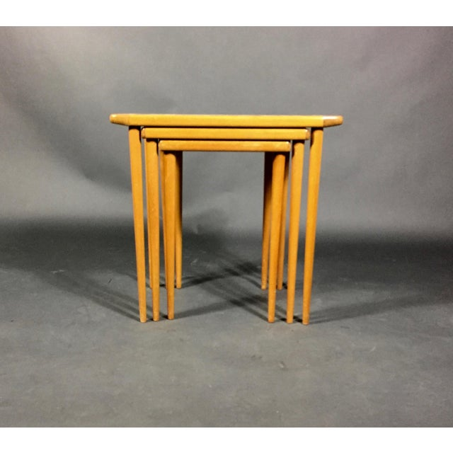 Set of three birch nesting tables from the 1960s, purchased in Sweden though uncertain as to manufacture. Unique and...