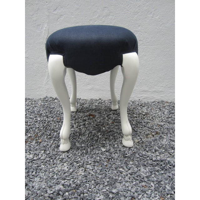 Whimsical goat leg stool in chalky plaster white finish and newly upholstered in navy linen.