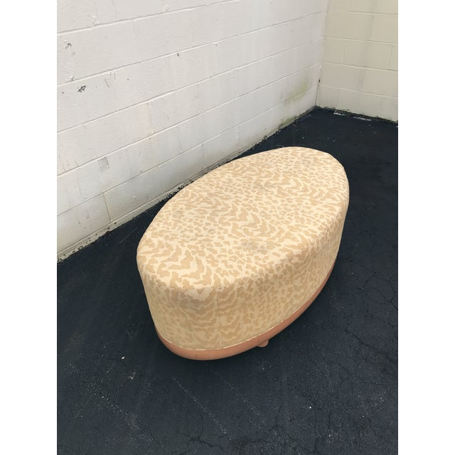 Beautiful cream and gold leopard type print ottoman. It's very large and sturdy. This would really spice up your living...