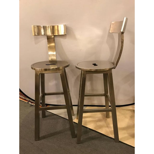 "A Pair Of Deco Style Steel Bar Stool. Each having a 30"" seat to floor. The circular seat leading to a T shaped back on..."