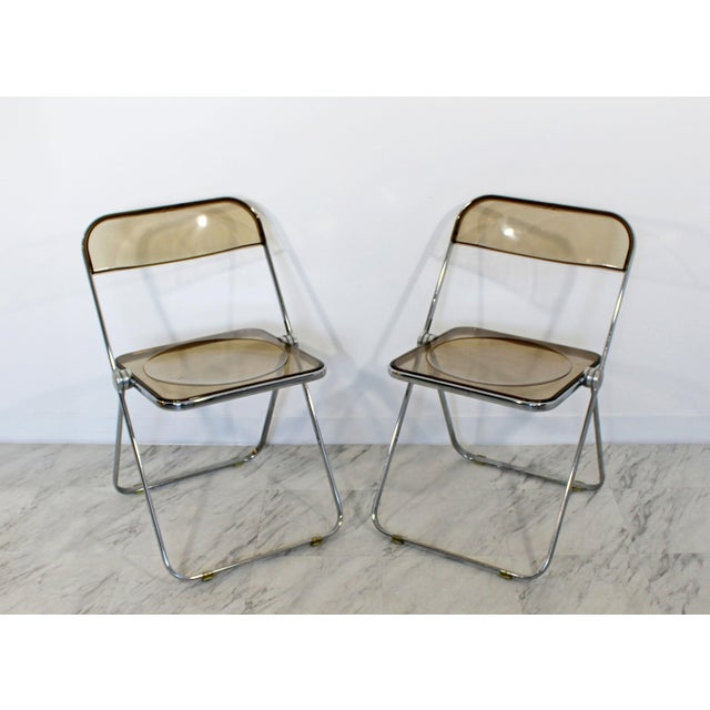 For your consideration is a wonderful set of ten folding chairs, made of chrome and smoked lucite, by Castelli, made in...