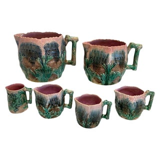 Collection of Six Etruscan Majolica Shell and Seaweed Pitchers For Sale