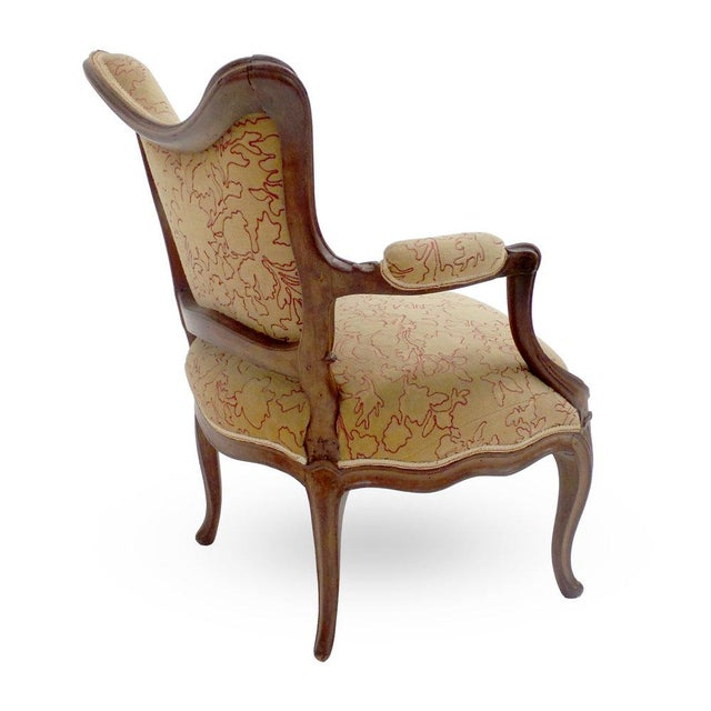 An 18th century Louis XV beechwood Coiffeuse armchair attributed to Louis Delanois, circa 1761. Provenance: This chair was...