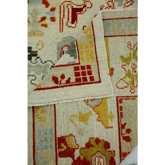 Turkish Oushak Rug With Red & Yellow Floral Details on Ivory Field For Sale - Image 9 of 10