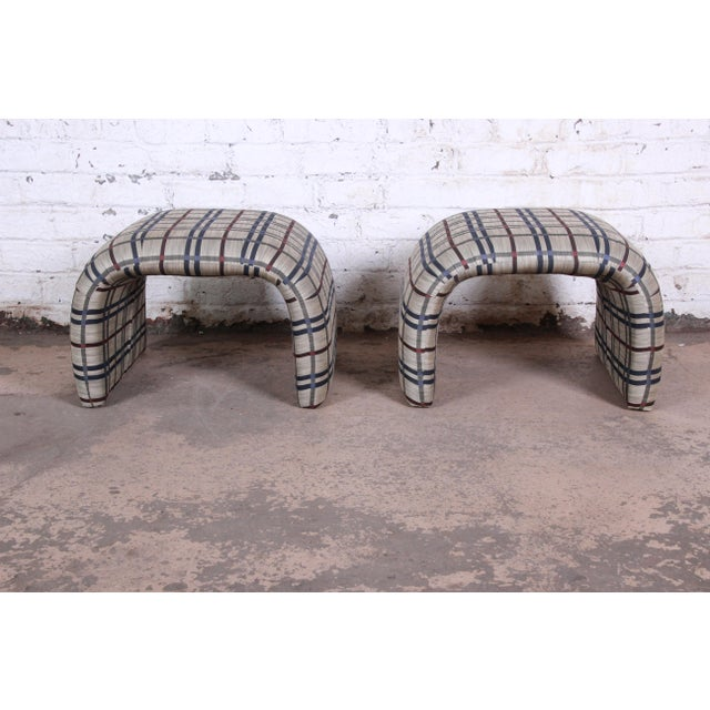 A gorgeous pair of mid-century modern upholstered stools or ottomans by Leon Rosen for Pace Collection. The stools feature...
