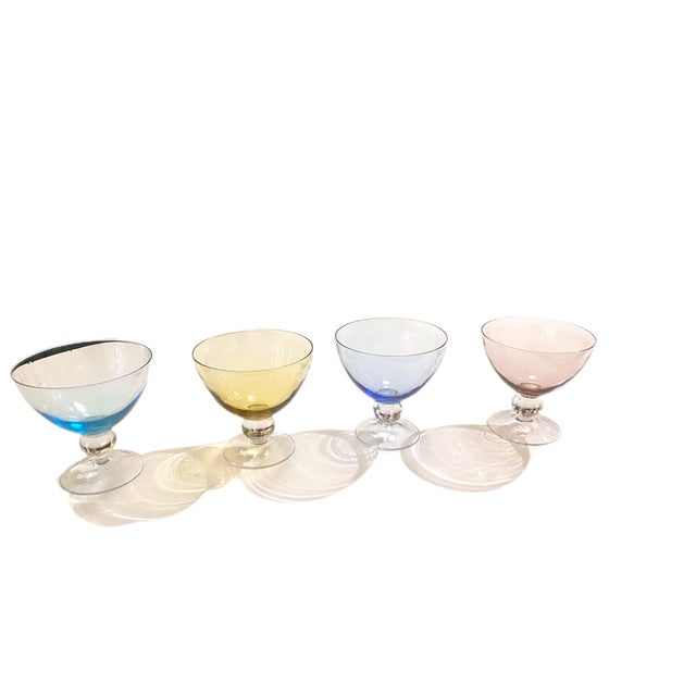 A set of 4 lovely dessert glass stemmed bowls. Beautiful bright colors and in excellent condition with no chips or cracks....