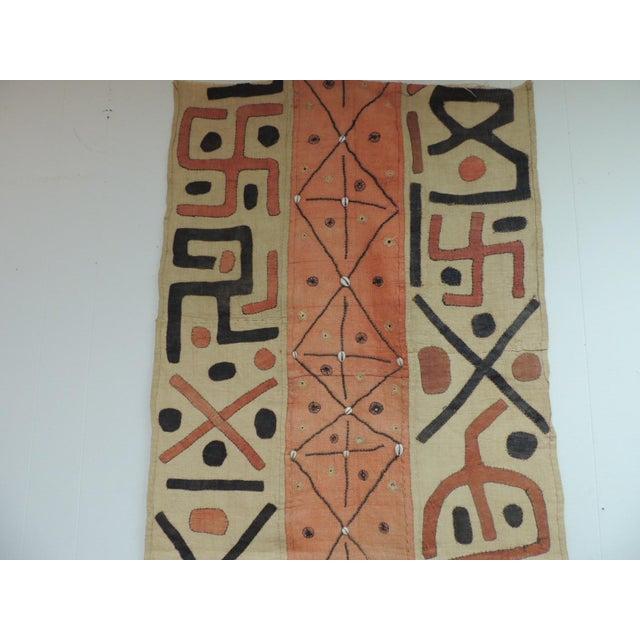 Large vintage orange and black African Applique Ceremonial Applique Kuba Raffia skirt panel. Tribal pattern embroidered...