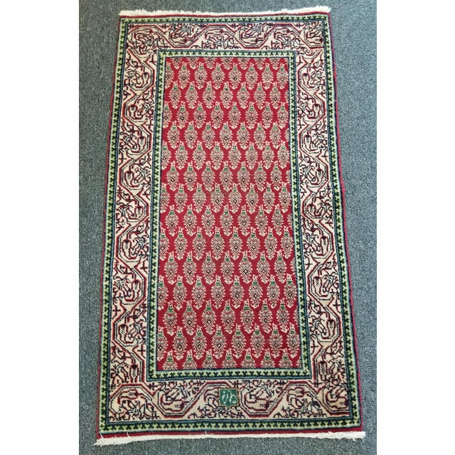 Hello and welcome! This is a arak Persian rug from the 1950s. This signed rug showcases an all over pattern indicative of...