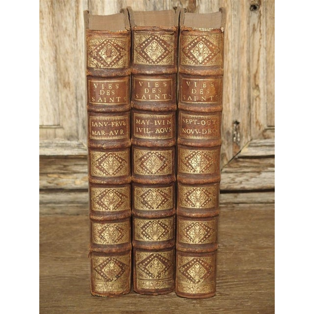 Set of 18th Century French Leather Bound Books, Les Vies Des Saints, 1715 For Sale - Image 9 of 13