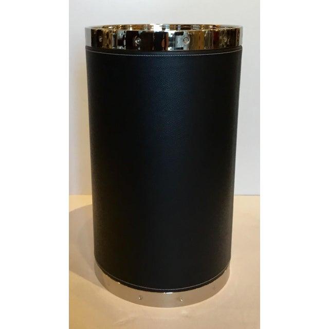 Modern black leather and nickel barrel side table, showroom floor sample