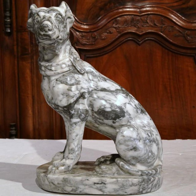 Wonderful antique marble dog figurine from France, circa 1870, with carved collar and in a seated position. Excellent...