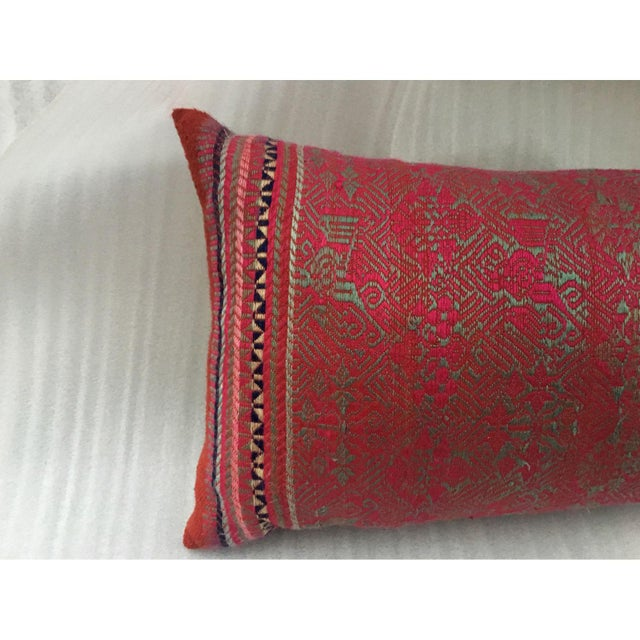 This is an absolutely stunning custom pillow made with an antique hand woven silk dowry wedding quilt woven by the...