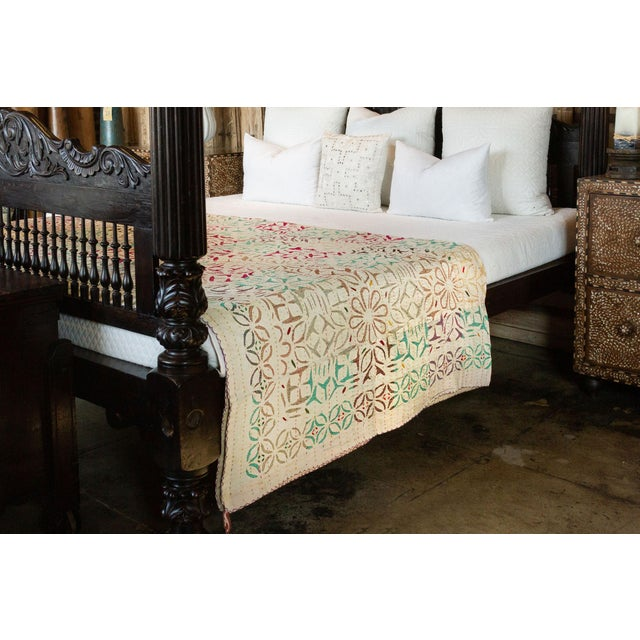 Pastel-hued cotton tribal coverlet featuring thread and mirror work by the Kathodi tribe in Gujarat, India. This...