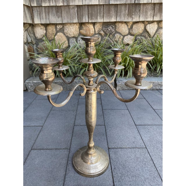 "A pair of beautiful silver-plate 5-arm candelabras measuring 17"" x 17"" x 21.5"". One is more heavily tarnished than the..."
