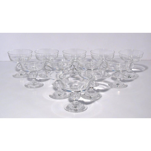 Set of 12 Steuben crystal champagne glasses, pattern 7926. Classic glasses each having a squared bowl over a baluster-form...