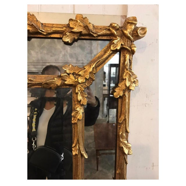 A very fine Italian 19th century Baroque Revival style Florentine giltwood carved mirror frame, with carved branches with...