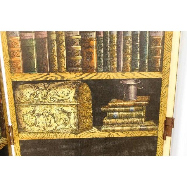 "Piero Fornasetti(1913-1988). Folding screen ""Bosco con Balaustra-Libri."" Lacquered wood, brass, lithographic printing...."