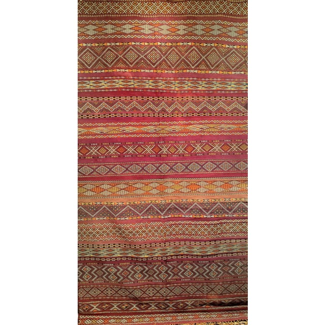 Moroccan Kilim with multiple stripes with various of design in each. Beautiful geometric designs in vibrant colors...