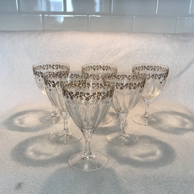 Lovely set of vintage Crystal Goblets with adorable gold leaves in circling the rim of the goblet
