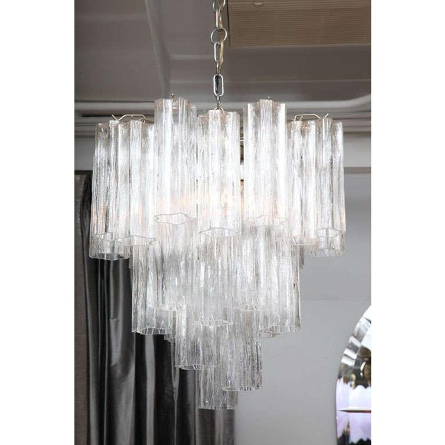 A striking and glamorous Venini four-tier chandelier with scalloped, textured crystals.