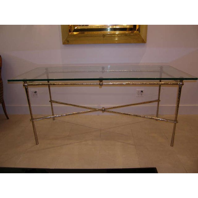 A nickel over cast bronze dining table or desk with glass top, French C.1960's The table can accommodate a large glass...