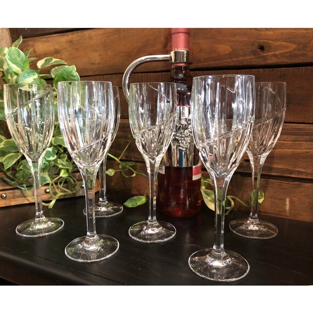 This is for a beautiful set of Mikasa Uptown wine glasses, but they can also be used for water. They measure 8.25 inches...