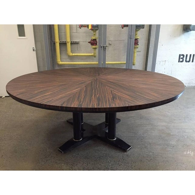 Large Italian zebra wood center table. Very nice zebra wood grain with a black lacquered base. Can also be used as a...