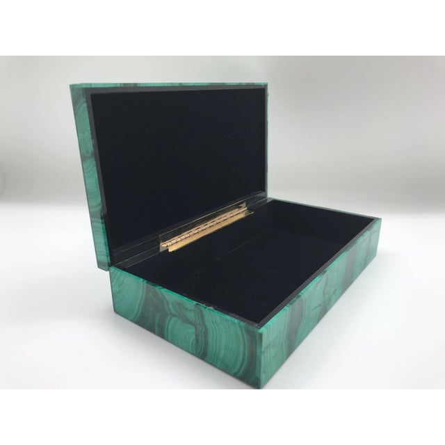 The malachite for this box was sourced from the Congo, where the finest quality of this mineral is currently found....