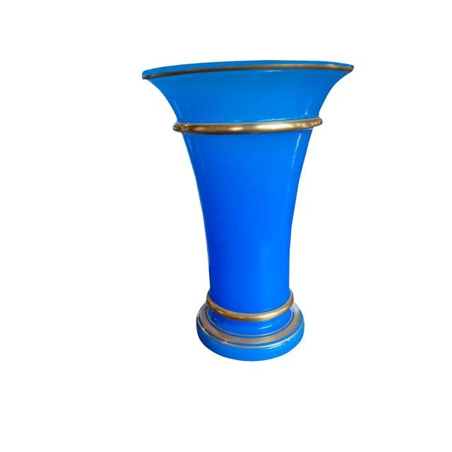 An antique French blue opaline glass vase with gilt trim. Circa 1850.