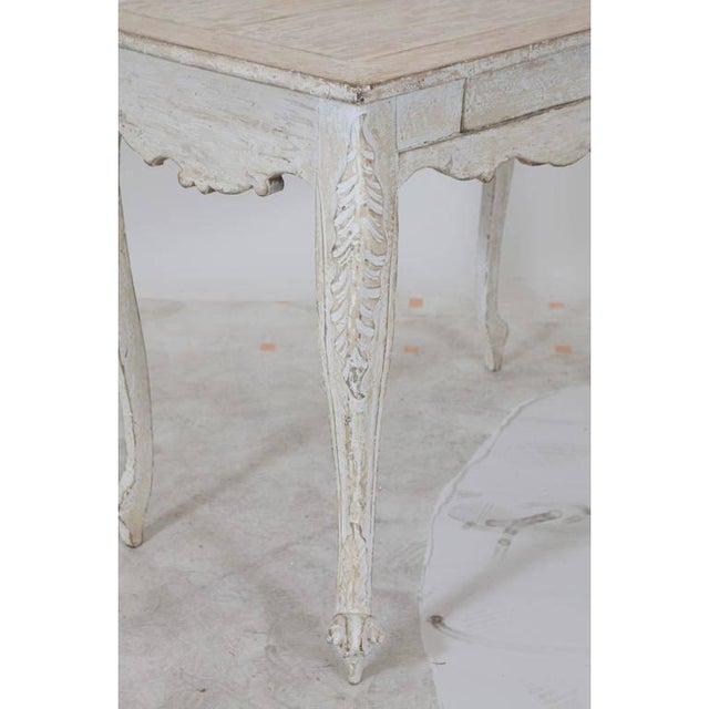 Pale white/grey Gustavian table with one drawer and sculptured legs and sides.