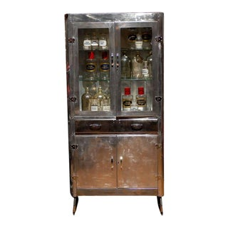 1950s English Polished Aluminum Glass Door Cabinet with Drawer and Lower Doors For Sale