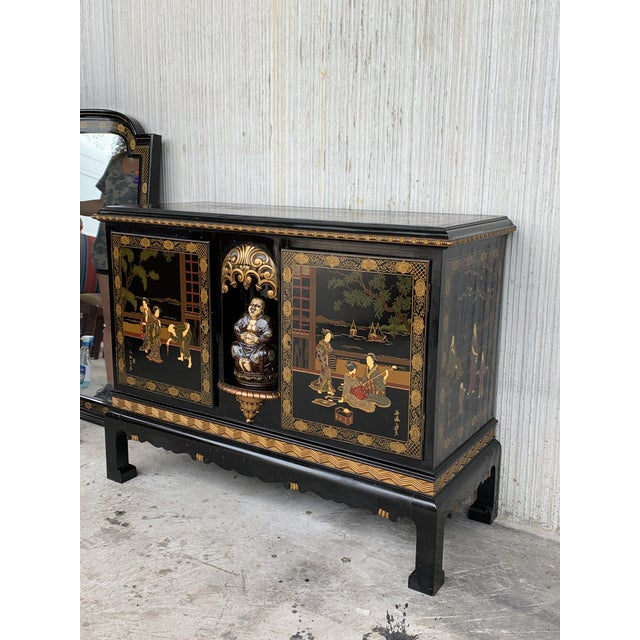 About This incomparable chinoiserie black lacquer sideboard depicts figures in various typical traditional scenes. What...