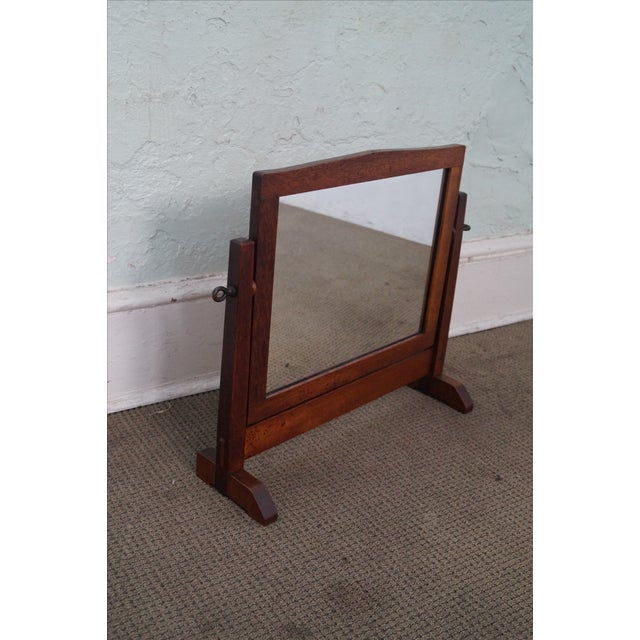 An antique, Stickley, Mission Oak, shaving mirror that is 100 years old, America made and features a solid oak frame and...