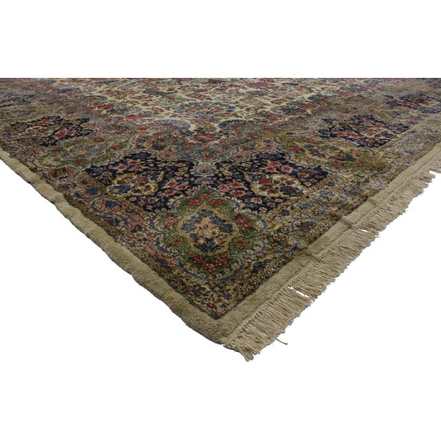 Absolutely magnificent with classical beauty, this Persian Kirman rug is characterized predominantly by an impeccable...