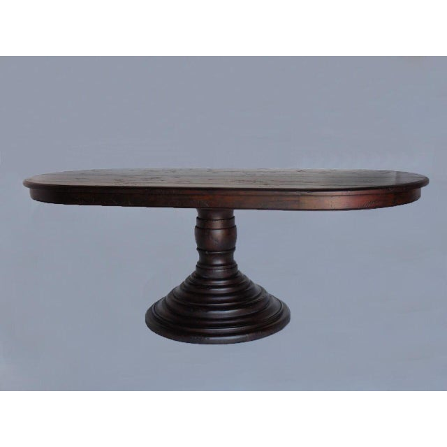 Beehive pedestal table with oval top in Walnut. Can be made in any size and in a variety of woods, finishes as distress....