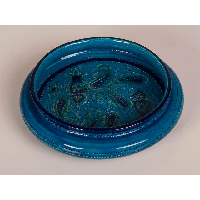 A large Italian Bitossi factory earthenware bowl in a stunning turquoise glaze finish having an inverted rim circa 1965....