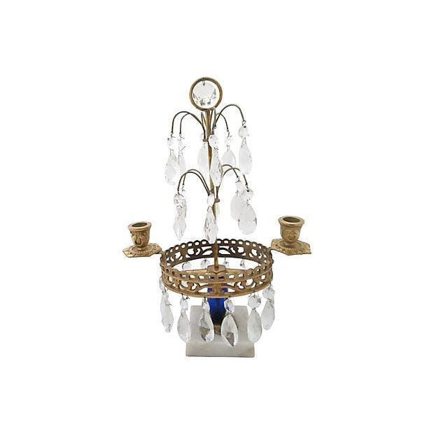 Swedish Gustavian-style two-arm candle holder adorned with hanging crystals mounted on a marble base. Handmade blue glass...
