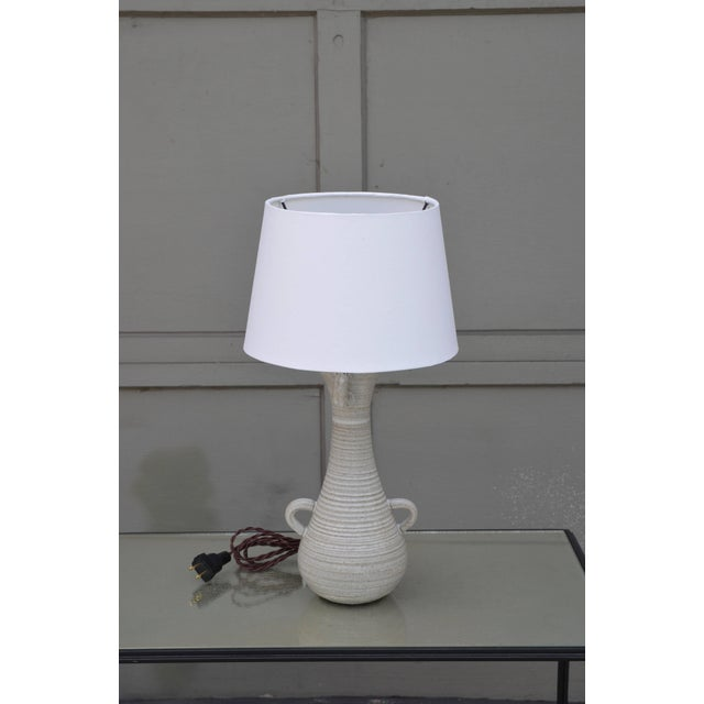 Chic gourd shaped table lamp with custom white parchment shade. The shade itself is 8 in. diameter at top x 10 in....