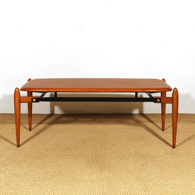 Coffee table in solid teak with ebony strips, french polish, black iron structure with brass hardware. Italy circa 1950