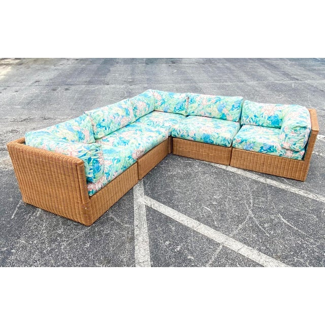 Fantastic Coastal printed Sectional. Beautiful bright clear pastel colors. A high back woven rattan frame. A double welt...