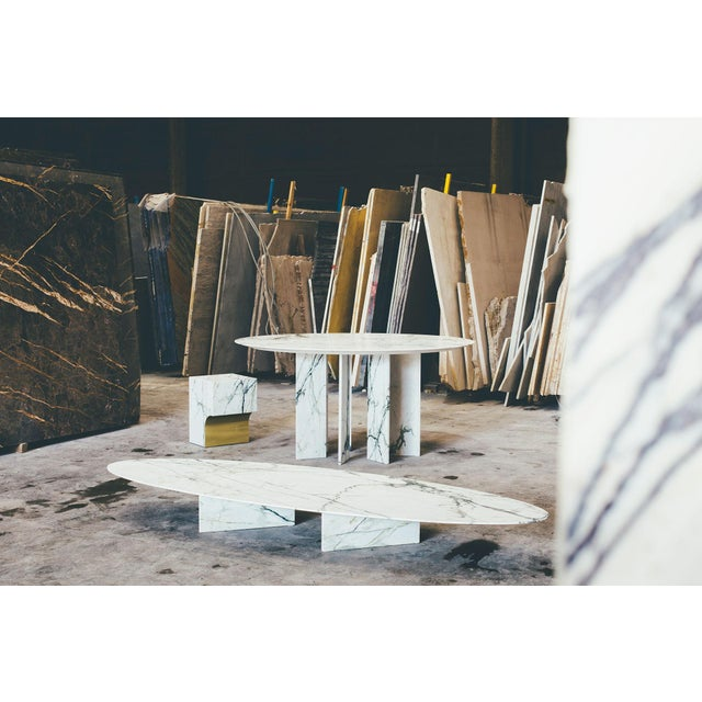 Arch dining table by Jeroen Thys van den Audenaerde Dimensions: 74 x 140 x 120 cm Marble and brass Made of carefully...