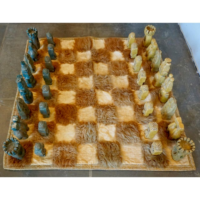 """Unique Mayan chess pieces,glazed ceramic on a shag board.The tallest pieces measure 10"""" and the smallest are 5"""". The board..."""